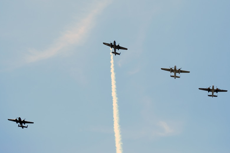 "Four B-25 bombers fly the ""Missing Man"" formation over the Memorial Service honoring the 75th anniversary of the Doolittle Japan Raid on April 18, 1942. The memorial service, held at the National Museum of the United States Air Force April 18, 2017, included two B-25 fly-overs. The first was a typical bomber staggered formation, and included 11 aircraft. The second was the Missing Man formation and honored the 79 members of the original Raiders who have passed. The last living Raider, Lt. Col. Richard Cole, was a participant in the memorial ceremony.  (U.S. Air Force photo/Wesley Farnsworth)"