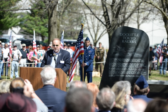 "Jeff Thatcher, son of Doolittle Raider, Staff Sgt. David Thatcher, gives remarks at the National Museum of the United States Air Force April 18, 2017. The memorial service, including a wreath laying, honored the 75th anniversary of the Doolittle Tokyo Raid in which 80 volunteers used 16 B-25 bombers to strike the Japanese mainland from the USS Hornet aircraft carrier, turning the tide of World War II. The ceremony included two flyovers of B-25 bombers, one in the missing man formation, and a B-1B bomber flyover, one of which had been rechristened the ""Ruptured Duck"" in a ceremony the day before. Staff Sgt. Thatcher was a crew member on the original Ruptured Duck, during the Doolittle Raid. (U.S. Air Force photo/Wesley Farnsworth)"
