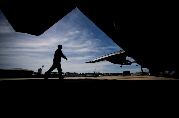 Staff Sgt. Alex Almarales, a special missions aviator with the 4th Special Operations Squadron, conducts preflight inspections of an AC-130U Spooky gunship at Hurlburt Field, Fla., April 17, 2017. The AC-130U gunship's primary missions are close air support, air interdiction and armed reconnaissance. (U.S. Air Force photo by Airman 1st Class Joseph Pick)