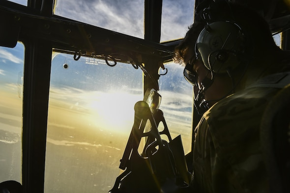Capt. Jonathan Rodgers, an AC-130U Spooky gunship pilot with the 4th Special Operations Squadron, scans the horizon during a live-fire training mission at the Eglin Range, Fla., April 17, 2017. Aircrew with the 4th SOS conducted a live-fire training mission to ensure mission readiness any time, any place. (U.S. Air Force photo by Airman 1st Class Joseph Pick)