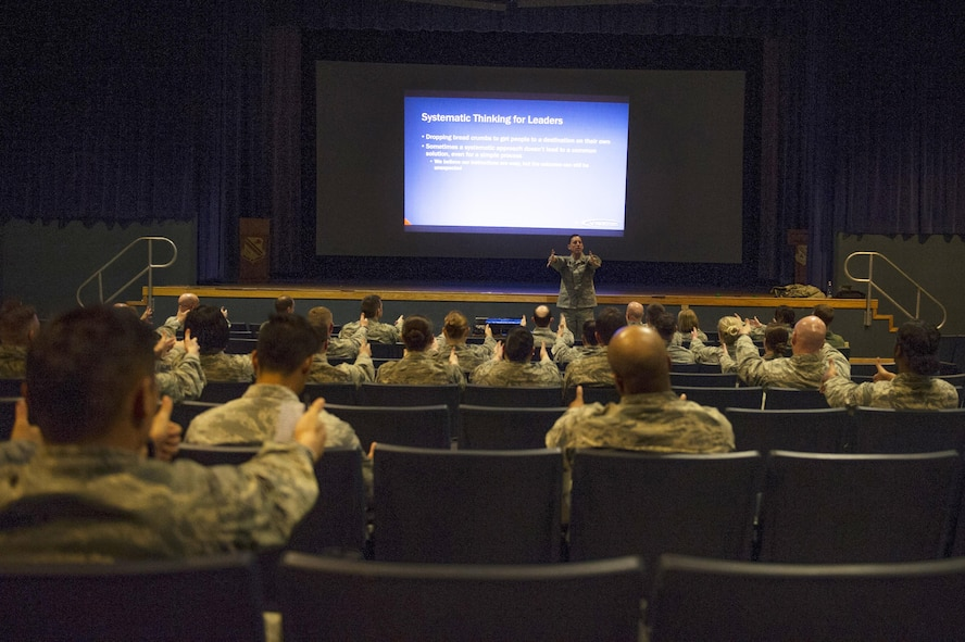 U.S. Air Force Lt. Col. Regan Patrick, a Profession of Arms Center of Excellence instructor, speaks to Airmen from the 354th Fighter Wing about systematic thinking April 13, 2016, at Eielson Air Force Base, Alaska. The talk was part of a professional development seminar themed 'Enhancing Human Capital'. (U.S. Air Force photo by Airman 1st Class Isaac Johnson)
