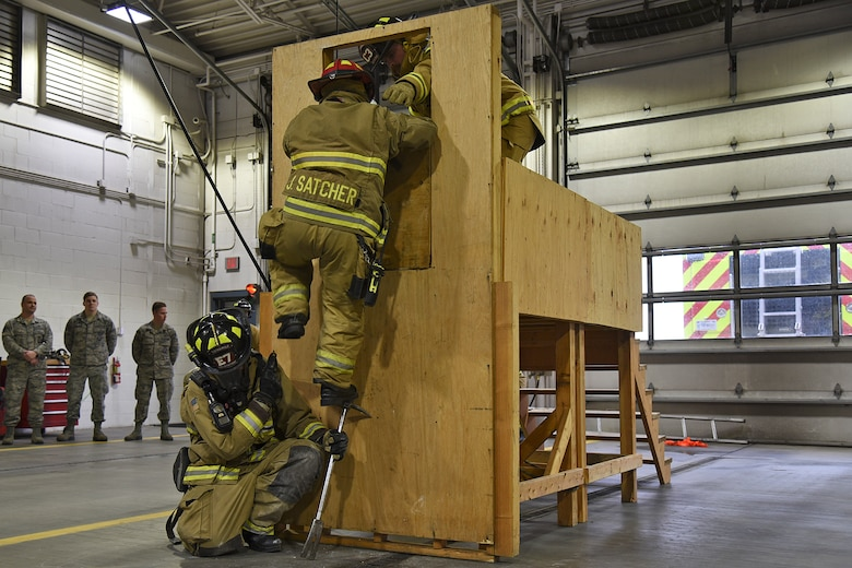 92nd Civil Engineer Squadron firefighters complete the last step of the Rapid Intervention Crew training course Mar. 29, 2017, at Fairchild Air Force Base, Washington. The team must work together to safely rescue and evacuate fellow firefighters who are injured or lost within a structure fire. (U.S. Air Force photo/Senior Airman Mackenzie Richardson)