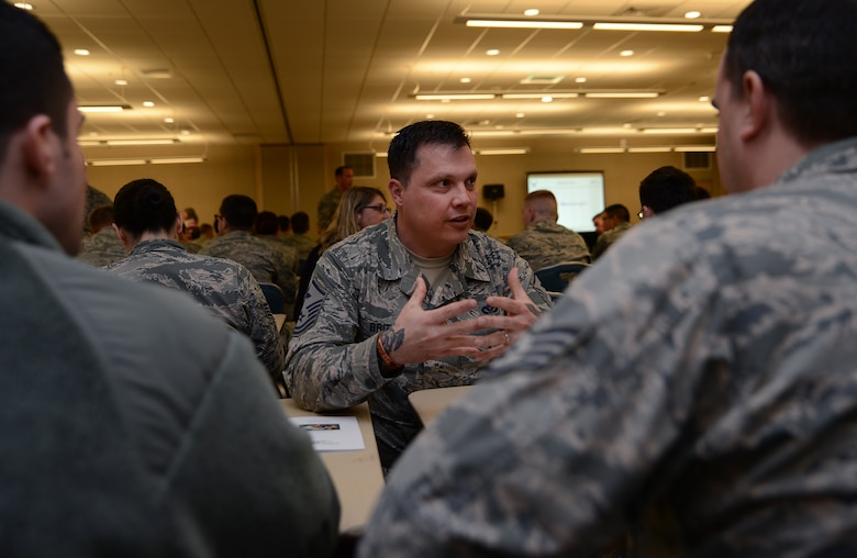 Master Sgt. Ruan Brits, 4th Airlift Squadron first sergeant, mentors Airmen on safety during Wingman Day April 14, 2017, at Joint Base Lewis-McChord, Wash. Mentors gave advice on various topics to include resiliency, health, finances, spiritual health, educational resources, goal setting, transitioning from the military, stress management and leadership. (U.S. Air Force photo/Senior Airman Jacob Jimenez)