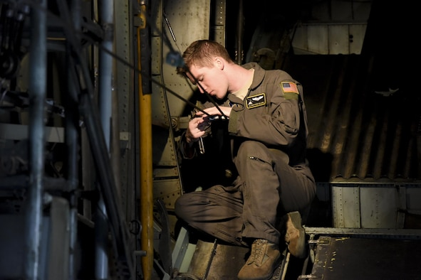 Airman 1st Class Christian Williams, 36th Airlift Squadron loadmaster, performs preflight checks on a C-130 Hercules before takeoff for a personnel drop training exercise on April13, 2017, at Yokota Air Base, Japan. The personnel drops were a part of Survival, Evasion, Resistance and Escape working group to remain current and proficient (U.S. Air Force photo by Machiko Arita)