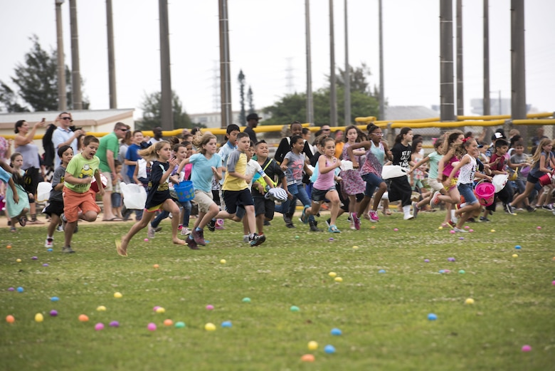Children race to collect Easter eggs scattered on the Four Diamonds Softball Field April 15, 2017, at Kadena Air Base, Japan. The Eggsplosion, an annual event hosted by the 18th Force Support Squadron, had egg hunts for different age groups, cultural demonstrations, food and prizes. Volunteers hid more than 50,000 eggs for the children to find. (U.S. Air Force photo by Senior Airman Omari Bernard/Released)