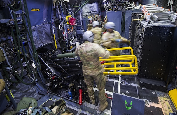 Special missions aviators with the 4th Special Operations Squadron reload the 105mm and 40mm canons on an AC-130U Spooky gunship during a live-fire training mission at the Eglin Range, Fla., April 17, 2017. The AC-130U gunship's primary missions are close air support, air interdiction and armed reconnaissance. (U.S. Air Force photo by Airman 1st Class Joseph Pick)