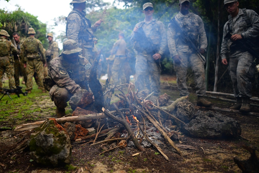 U.S. Air Force service members cook a snake during Cope North 17 survival training at Andersen Air Force Base, Guam, Feb. 17, 2017. Cope North allowed service members to come together to share jungle survival tactics to enhance interoperability in the event of a survival situation. (U.S. Air Force photo by Airman 1st Class Christopher Quail)