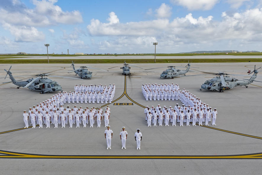 The members of Helicopter Sea Combat Squadron Two-Five pose for a group photo April 18, 2017, at Andersen Air Force Base, Guam. HSC-25 operates the MH-60S Knighthawk providing Andersen AFB 24-hour search and rescue support. (U.S. Air Force photo by Airman 1st Class Christopher Quail)