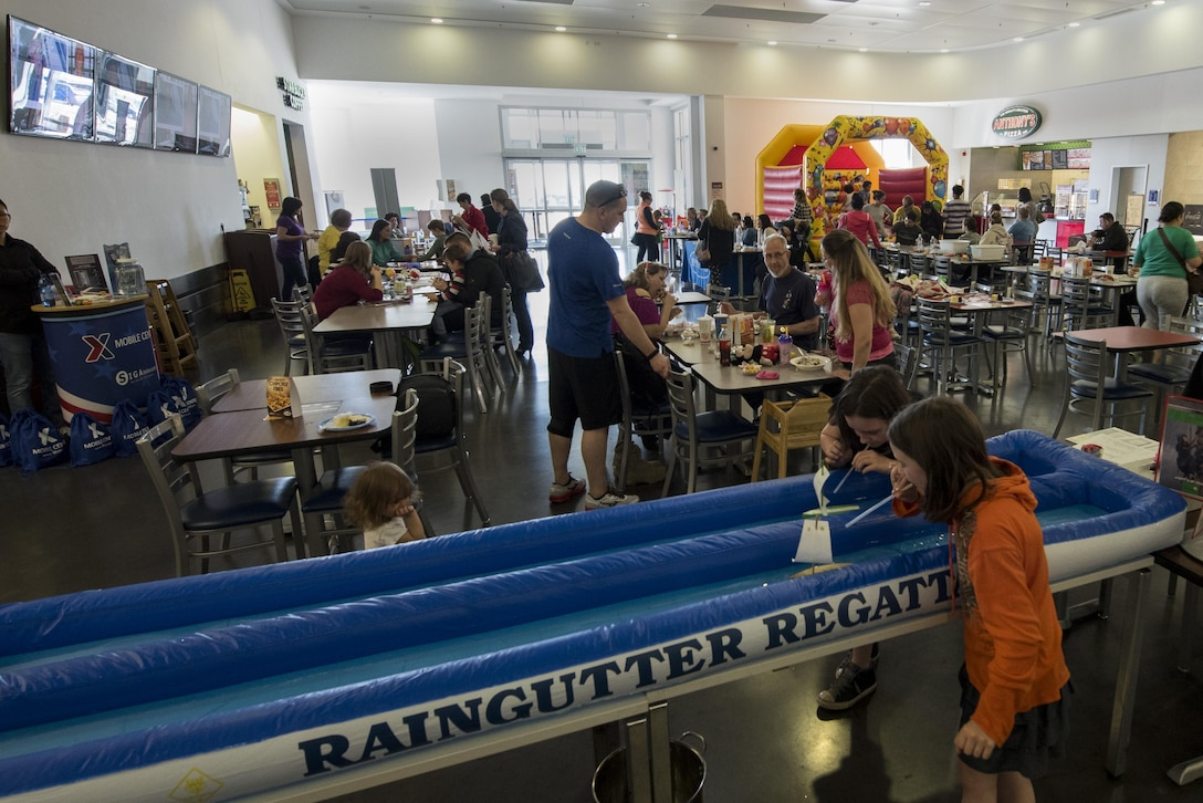 Spangdahlem families participate in activities during the fourth annual Spring Fling event held at the Base Exchange at Spangdahlem Air Base, Germany, April 14, 2017. The event is held annually and serves to bring awareness to the Exceptional Family Member Program during month of the military child. (U.S. Air Force photo by Airman 1st Class Preston Cherry)
