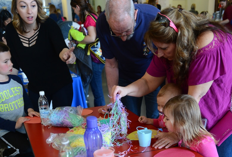 Spangdahlem families decorate paper eggs during the fourth annual Spring Fling event held at the Base Exchange at Spangdahlem Air Base, Germany, April 14, 2017. The Exceptional Family Member Program, along with other various organizations, hosted the event to raise awareness of EFMP and the service it provides for families. (U.S. Air Force photo by Airman 1st Class Preston Cherry)