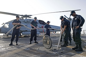 Sailors stow a mooring line aboard the guided-missile destroyer USS Truxtun (DDG 103) while leaving port in Duqm, Oman. Truxtun is deployed in the U.S. 5th Fleet area of operations in support of maritime security operations designed to reassure allies and partners and preserve the freedom of navigation and the free flow of commerce in the region.