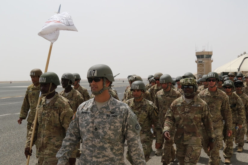 Air Assault candidates, led by U.S. Army Sgt. 1st Class Renato Defreitas, instructor, Basic Leaders Course, march toward a rally point after successfully completing their rappel from a UH-60 Black Hawk helicopter April 13, 2017, at Camp Buehring, Kuwait. The Air Assault Course allows U.S. military personnel in the U.S. Army Central area of operations the unique opportunity to become air assault qualified, while deployed outside the continental United States.