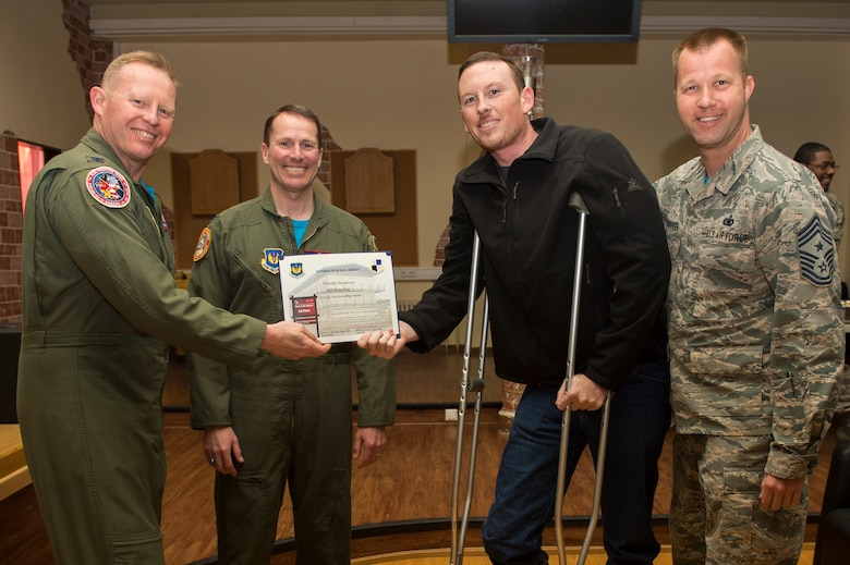 Spangdahlem's leadership team presents Airman 1st Class Beau Clay, 52nd Civil Engineer Squadron water and fuel systems apprentice, with a certificate for winning first place in the Dorm of the Quarter awards held in the Brick House at Spangdahlem Air Base, Germany, April 14, 2017. Each quarter an Airman is recognized for the best dorm room on base. (U.S. Air Force photo by Airman 1st Class Preston Cherry)
