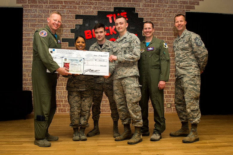 Spangdahlem's leadership team presents 52nd Security Forces Squadron Dorm 335 members with a check for $1,000 and a certificate for winning first place at the Dorm of the Quarter awards held in the Brick House at Spangdahlem Air Base, Germany, April 14, 2017. The funds awarded will go towards improvements and renovations for Dorm 335. (U.S. Air Force photo by Airman 1st Class Preston Cherry)