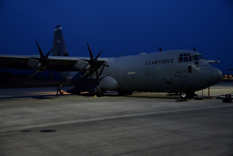 A C-130 aircraft rests on the flightline April 15, on Ramstein Air Base, Germany. The aircraft is scheduled to transport a Tactical Air Navigation system to Romania in support of the theatre security package. (U.S. Air Force photo by Airman 1st Class D. Blake Browning)