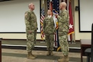 Lt. Gen. Charles D. Luckey, right, chief, Army Reserve and U.S. Army Reserve Command commanding general, prepares hand the colors to Command Sgt. Maj. Ted L. Copeland, during a change of responsibility ceremony at the U.S. Army Forces Command and U.S. Army Reserve Command headquarters, April 18, 2017, at Fort Bragg, NC. Copeland takes over the U.S. Army Reserve's top enlisted position after serving as the command sergeant major of the 79th Sustainment Support Command in Los Alamitos, Calif. (U.S. Army photo by Timothy L. Hale/Released)