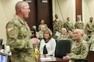 Grace Copeland, seated, listens to her husband, U.S. Army Reserve Command Sgt. Maj. Ted L. Copeland, as he gives his remarks during a change of responsibility ceremony at the U.S. Army Forces Command and U.S. Army Reserve Command headquarters, April 18, 2017, at Fort Bragg, NC. Copeland takes over the U.S. Army Reserve's top enlisted position after serving as the command sergeant major of the 79th Sustainment Support Command in Los Alamitos, Calif. (U.S. Army photo by Timothy L. Hale/Released)