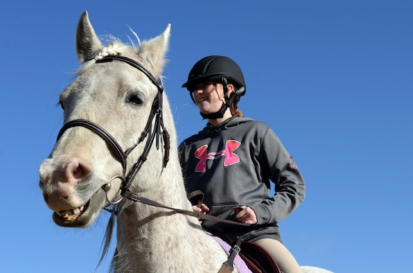 Payton Connor, daughter of 91st Missile Wing Commander Col. Colin Connor, rides her horse Sterling at the Dufresne Riding Club Stables at Minot Air Force Base, N.D., April 11, 2017. New horses must remain in quarantine for 10 days before they can enter the stables. (U.S. Air Force photo/Airman 1st Class Austin M. Thomas)