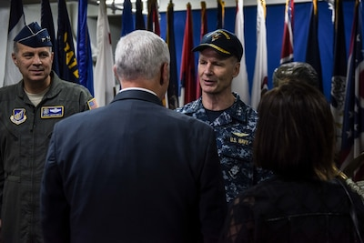 Navy Vice Adm. Joseph Aucoin, the commander of U.S. 7th Fleet, greets Vice President Mike Pence aboard the aircraft carrier USS Ronald Reagan in Yokosuka, Japan, April 19, 2017. Navy photo by Petty Officer 2nd Class Jamal McNeill