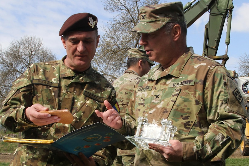 Army Col. Paul Mattern, commander of the 926th Engineer Brigade, and Romanian Land Forces Brig. Gen. Gheorghe Soare, commander of the 10th Engineer Brigade, exchange gifts after the opening ceremony for Resolute Castle 2017 at Cincu Training Center, Romania, April 14, 2017. Army photo by Pvt. Nicholas Vidro