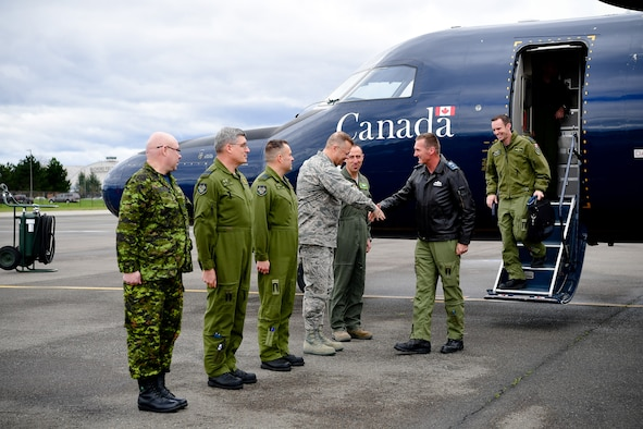 Canadian Brig. Gen. David Cochrane, 2nd Canadian Air Division commander, is greeted upon landing by 62nd Airlift Wing and Western Air Defense Sector leadership April 6.  As part of Cochrane's official visit to Joint Base Lewis-McChord, he received a WADS mission briefing and operations floor tour prior to his attendance as the guest speaker for the WADS Canadian Detachment's annual Mess Dinner marking the 93rd anniversary of the formation of the Royal Canadian Air Force. Pictured from left to right: Canadian Warrant Officer Rick Martin, WADS Canadian Detachment, Canadian Capt. Robert Bell, WADS Canadian Detachment, Canadian Lt. Col. Matt Wappler, WADS Canadian Detachment commander, Col. Gregor Leist, WADS commander and Col. Leonard Kosinski, 62nd Airlift Wing commander, Canadian Brig. Gen. David Cochrane, 2nd CAD commander, and Canadian Capt. Brian Noel, 2nd CAD commander executive assistant.  (U.S. Air Force photo by Kimberly D. Burke)