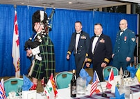 Canadian Brig. Gen. David Cochrane (second from left), 2nd Canadian Air Division commander and Canadian Lt. Col. Matt Wappler (second from right), Western Air Defense Sector Canadian Detachment commander, are led by bagpiper Van Bradley symbolizing the start of the Canadian Mess Dinner.  The annual dinner marked the 93rd anniversary of the formation of the Royal Canadian Air Force (RCAF).  At the end of the night, Cochrane formally recognized WADS with the 2nd CAD Commander's Unit Commendation for providing critical live and virtual training to Canadian aerospace controllers from the 51 Aerospace Control and Warning (Operational Training) Squadron located in North Bay, Ontario. (Courtesy photo by Conrad Neumann III)