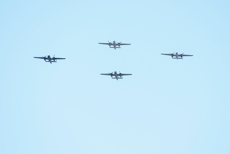 A group of B-25 bombers flies over the National Museum of the United States Air Force in a typical bomber staggered formation, April 18, 2017 as part of the 75th Anniversary of the Doolittle Raid Memorial Ceremony. They then flew over the museum one last time in the Missing Man formation and honored the 79 members of the original Raiders who have passed. The last living Raider, Lt. Col. (Ret.) Richard Cole, was a participant in the memorial ceremony. (U.S. Air Force photo/Wesley Farnsworth)