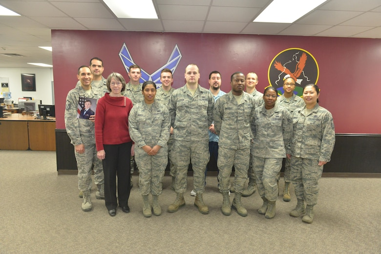 The 5th Comptroller Squadron stands for a group photo at Minot Air Force Base, N.D., April 4, 2017. The 5th CPTS recently took home the title of the Air Force Financial Services Office of the Year. (U.S. Air Force photo/Airman 1st Class Jessica Weissman)