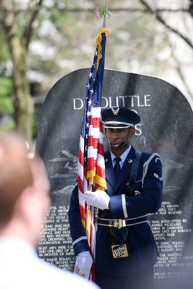 Airman 1st Class Izan Velazquez, a ceremonial guardsman with the Wright-Patterson Air Force Base Honor Guard, presents the American Flag during the 75th Anniversary memorial ceremony of the Doolittle Tokyo Raid, April 18, 2017 at the National Museum of the United States Air Force in Dayton, Ohio. The memorial service also included a wreath laying honoring the 80 volunteers who flew 16 B-25 bombers to strike the Japanese mainland from the USS Hornet aircraft carrier, turning the tide of World War II. (U.S. Air Force photo/Wesley Farnsworth)