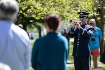 Master Sgt. Mike Richter, a musician with Wright Brass from the Air Force Band of Flight, plays taps at the conclusion of the 75th Anniversary memorial ceremony of the Doolittle Tokyo Raid, April 18, 2017 at the National Museum of the United States Air Force in Dayton, Ohio. Attending the ceremony was Lt. Col. (Ret.) Richard E. Cole, the sole surviving member of the Doolittle Raiders, and Jeff Thatcher, the son of Doolittle Raider Staff Sgt. David Thatcher, who passed in June 2016. (U.S. Air Force Photo/Wesley Farnsworth)