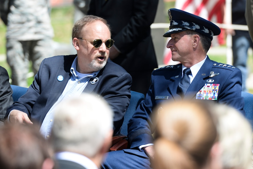Chief of Staff of the Air Force, Gen. David L. Goldfein, talks to Jeff Thatcher (left), the son of Doolittle Raider Staff Sgt. David Thatcher, who passed in June 2016, during the 75th Anniversary of the Doolittle Raid Memorial Ceremony at the National Museum of the United States Air Force, April 18, 2017. Also attending was Lt. Col. (Ret.) Richard E. Cole, the sole surviving member of the Doolittle Raiders. (U.S. Air Force Photo/ Wesley Farnsworth)