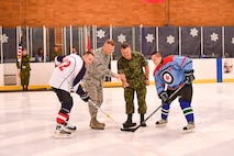 Col Gregor J. Leist, Western Air Defense Sector commander and Lt. Col. Matt Wappler, Canadian Detachment commander, drop the puck for the start of the 23rd annual Canada USA Hockey Classic.  Canada dominated with an 8-1 win.