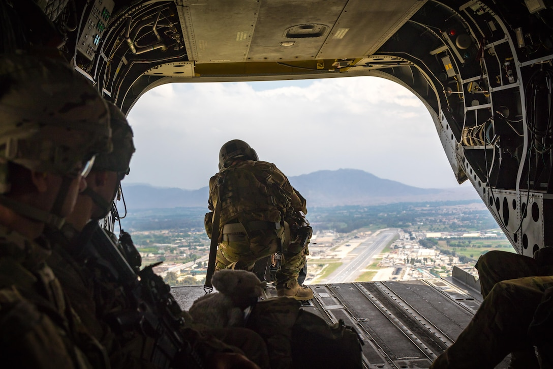A U.S. Army CH-47 helicopter crew chief assigned to Task Force Flying Dragons, 16th Combat Aviation Brigade, 7th Infantry Division scans below while flying near Jalalabad, Afghanistan, April 5, 2017. The Flying Dragons are preparing to assume their mission in support of Operation Freedom's Sentinel and Resolute Support Mission.