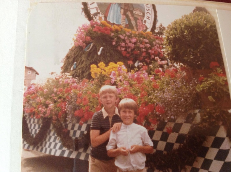 Matthew and James Hodges stand in front of a parade float in Garmisch-Partenkirchen, Germany in the early circa 1980. While moving often is a challenge military children are faced with, moving can be a positive experience giving military children a chance to live all over the world. (Courtesy photo)