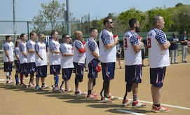 Wounded Warrior Amputee Softball Team members stand during the playing of the national anthem during the WWAST game against the Newport News police and fire departments in Newport News, Va., April 15, 2017. The WWAST challenged the Newport News first responders to a seven-inning game to raise awareness for wounded service members. (U.S. Air Force photo/Airman 1st Class Kaylee Dubois)
