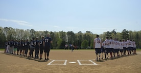 The Wounded Warrior Amputee Softball Team stand with the Newport News police and fire departments during the playing of the national anthem at the WWAST game in Newport News, Va., April 15, 2017. The WWAST is comprised of veterans and active-duty members who have lost limbs while serving in the military since 9/11. (U.S. Air Force photo/Airman 1st Class Kaylee Dubois)
