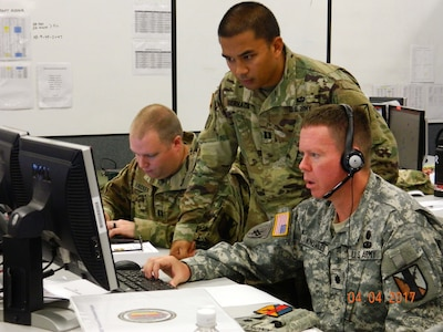 303rd Maneuver Enhancement Brigade Soldiers - Cpt. Thomas Hacker (left), Cpt. Allen Gervico (middle), and Lt. Col. Gordon Knowles (right), prepare for a commander's update brief during their participation in a warfighter exercise (WFX) hosted by the 25th Infantry Division at Mission Training Complex – Hawaii, Schofield Barracks, April 4, 2017. The exercise ran from April 3-12. It was the first time the 303rd MEB participated in a WFX since its activation just 4 years ago. As the only MEB in the Pacific region, the WFX enhances training to provide for proficiency in the Brigade's full mission capabilities on protection and freedom of maneuver within a battle area of operation.