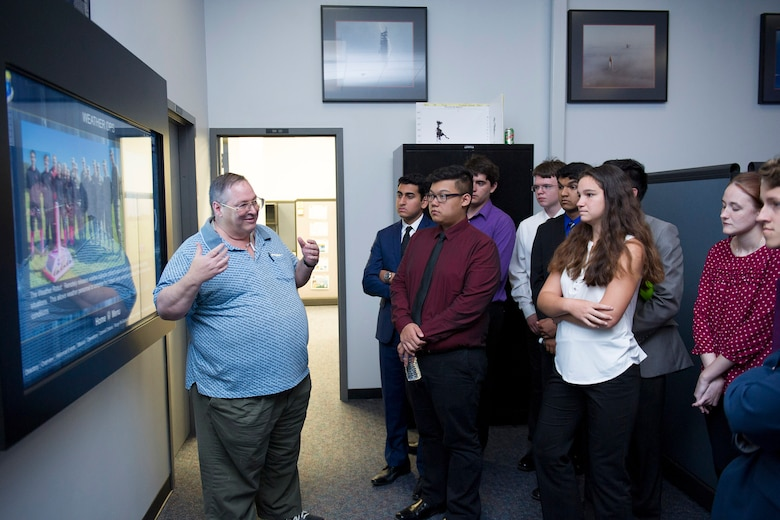 William Roeder, 45th Weather Squadron meteorologist, gives Lake Nona High School students a tour of the Morrell Operations Center April 18, 2017, at Cape Canaveral Air Force Station, Fla. Members of the 45th WS met with students to discuss their Lightning Launch Commit Criteria findings and results in regards to weather and climatology. Prior to the school year, Roeder reached out to the high school and introduced them to the project. The project provides students with real-world experience by following a business model of preparation, set-up, and using innovative methods to complete it. (U.S. Air Force photo by Phil Sunkel)