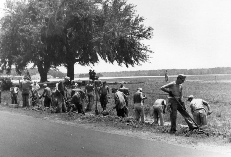 German Prisoner's of War work along the roadside near the Charleston Army Airfield.