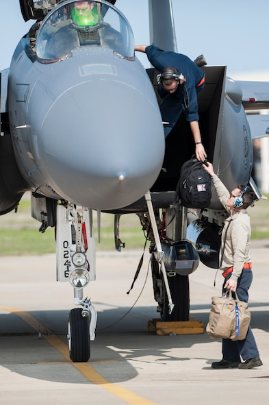 U.S. Air Force Airmen assigned to the 366th Maintenance Group at Mountain Home Air Force Base, Idaho, assists an F-15E Strike Eagle pilot at Joint Base Langley-Eustis, Va., April 14, 2017. The U.S. Air Force F-15E Strike Eagles and T-38 Talons played the roles of adversary aircraft during the ATLANTIC TRIDENT 17 exercise. (U.S. Air Force photo/Airman 1st Class Tristan Biese)