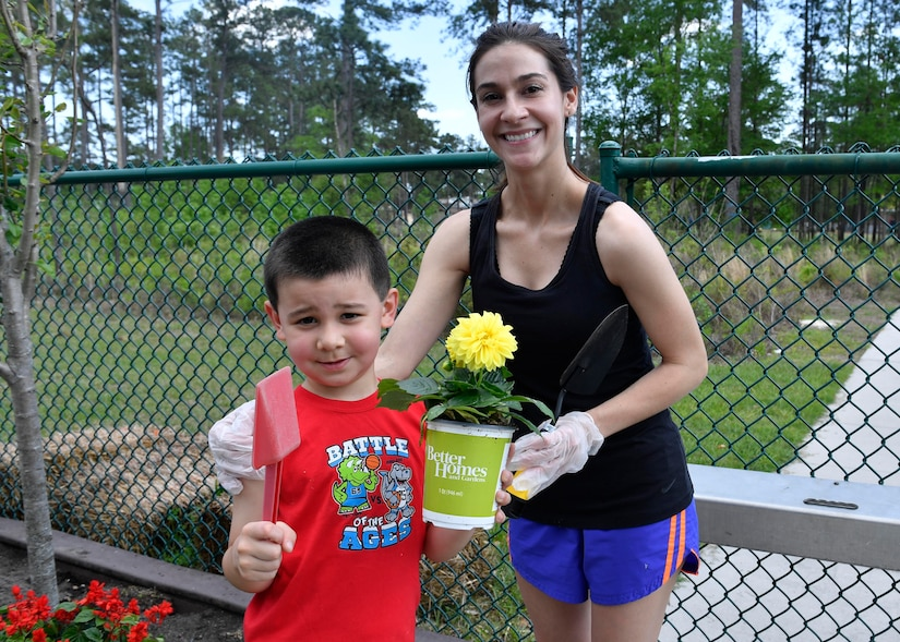 Kelley Lamberth and her son Ryan prepare to plant flowers at the Joint Base Charleston-Weapons Station Child Development Center, April 13, 2017. April was named Month of the Military Child by former Defense Secretary Casper Weinberger in 1989 to applaud military children for their daily sacrifices and the challenges they have overcome. The WS CDC is celebrating Month of the Military Child by hosting Wacky Hat Wednesdays, Purple Up! Fridays and planting gardens with parents and students.
