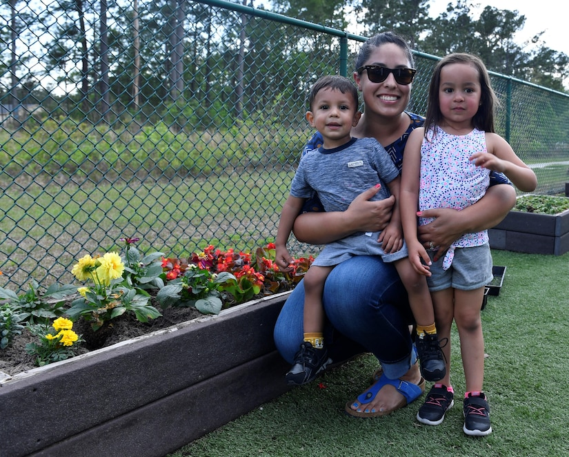 Danielle Hallquist, a military spouse, poses for a photo with her kids, Luna and Noah, at the Joint Base Charleston-Weapons Station Child Development Center, April 13, 2017. April was named Month of the Military Child by former Defense Secretary Casper Weinberger in 1989 to applaud military children for their daily sacrifices and the challenges they have overcome. The WS CDC is celebrating Month of the Military Child by hosting Wacky Hat Wednesdays, Purple Up! Fridays and planting gardens with parents and students.