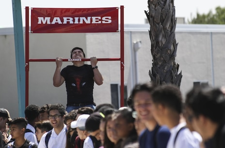 A student from Olympian High School, Chula Vista, California, executes as many pull-ups as he can to earn prizes from the pull-up challenge during the anti-bullying ASA tour, April 4, 2017. Marine Corps Recruiters from San Diego, ASA Entertainment staff and professional BMX riders traveled to multiple schools, April 3-7, 2017, to spread anti-bullying awareness and teach students how to prevent and react to different types of bullying. (U.S. Marine Corps photo by Sgt. William Hester/ Released)