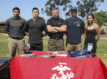 Sgt. Eric Moroney and his future Marines hold a pull-up challenge at Torrey Pines High School, April 5, 2017, in San Diego, California, during the ASA Entertainment's anti-bullying tour. During the tour Marine Corps recruiters, ASA Entertainment staff and BMX pro riders traveled to multiple schools, April 3-7, 2017, to spread anti-bullying awareness. Moroney, from Boston, Massachusetts,  is recruiter with Marine Corps Recruiting Station San Diego, 12th Marine Corps Recruiting District, Western Recruiting Region, Marine Corps Recruiting Command. (U.S. Marine Corps photo by Sgt. William Hester/ Released)