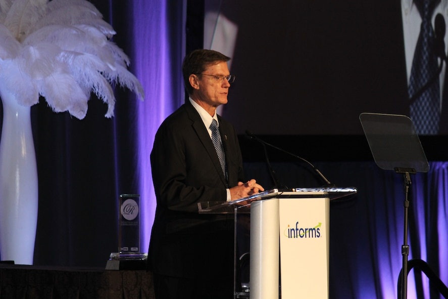 Kevin Williams, the director of Air Force studies, analyses and assessments, speaks after accepting the INFORMS Prize award on behalf of the Air Force Studies, Analysis and Assessments directorate April 3, 2017, at a gala in Las Vegas, Nev. The award is given to organizations that have repeatedly applied the principles of operations research in pioneering, carried, novel and lasting ways. (Courtesy photo)