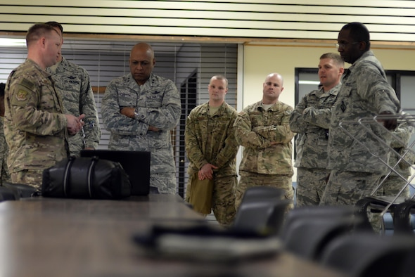 Maj. Gen. Anthony Cotton, 20th Air Force commander, and Airmen watch a training video at Minot Air Force Base, N.D., April 28, 2017. Cotton visited the 91st Security Forces Squadron's training building and a missile alert facility during his tour of the base. (U.S. Air Force photo/Airman 1st Class Austin M. Thomas)