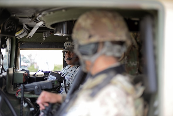 Maj. Gen. Anthony Cotton, 20th Air Force commander, speaks with an Airman inside a Humvee at Minot Air Force Base, N.D., April 28, 2017. Cotton visited the 91st Security Forces Squadron's training building and a missile alert facility during his tour of the base. (U.S. Air Force photo/Airman 1st Class Austin M. Thomas)