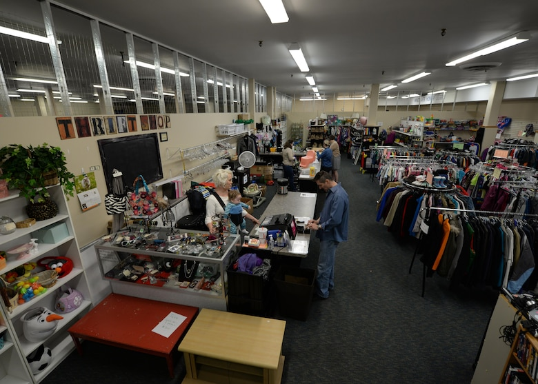 Thrift shop volunteers assist customers at Minot Air Force Base, N.D., April 7, 2017.  All profits made at the thrift shop go to multiple charities that help the community. (U.S. Air Force photo/ Airman 1st Class Dillon J. Audit)
