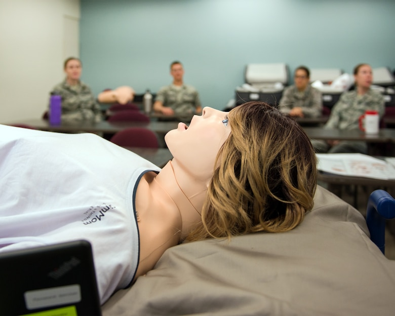 Medical staff conduct training on the new Complicated OB Emergency Simulator at Travis Air Force Base, Calif., April 10, 2017. Travis has been selected by the Defense Health Agency as one of five installations within DOD to be a pilot base for the new system. The system will provide a standardized platform for training for all levels of clinical staff to promote standardization on patient safety. (U.S. Air Force photo by Louis Briscese)