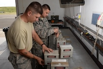 Senior Airman Ryan Laneville (Left) and Staff Sgt. Daniel Vendetta (Right), both members of the 60th Maintenance Squadron, break down flare mods at Travis Air Force Base, Calif., April 5, 2017. Laneville and Vendetta are part of the maintenance squadron's munitions team responsible for munitions valued at over $13 million. Flare mods are utilized by C-17 Globemaster III and C-5M Super Galaxy aircraft to counter airborne threats. (U.S. Air Force photo/Tech. Sgt. James Hodgman/Released)